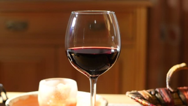 news glass of red wine